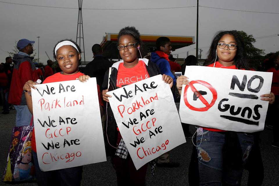 Tomaya Gayton, Jada Posey and Nanyamka Lopez, all freshman at Gary Comer College Prep school pose for a portrait after Pastor John Hannah of New Life Covenant Church lead a march and pray for our lives against gun violence in Chicago, Illinois, U.S., May 19, 2018.