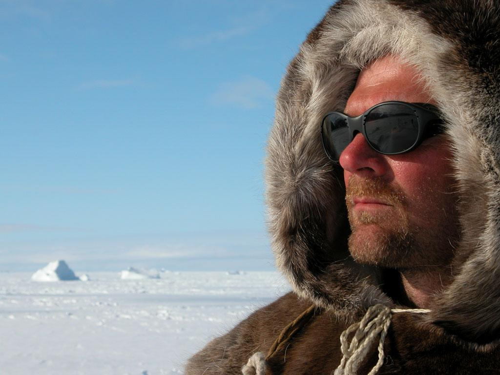 Host Les Stroud keeps warm in barren, snow-filled landscape as seen on Survivorman.