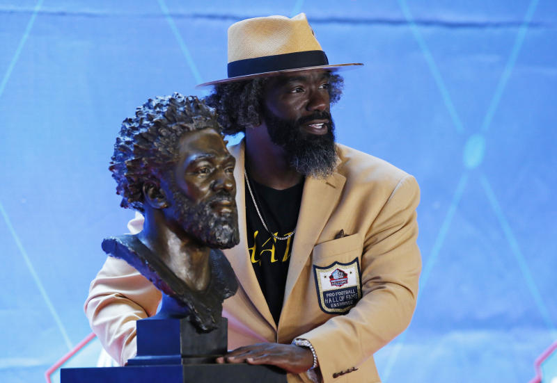 Ed Reed poses with his Pro Football Hall of Fame bust. (AP)