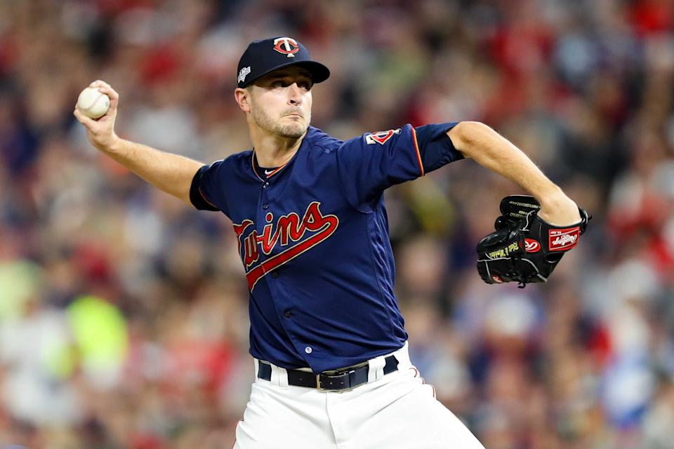 Oct 7, 2019; Minneapolis, MN, USA; Minnesota Twins starting pitcher Jake Odorizzi (12) delivers during the first inning of game three against the New York Yankees in the 2019 ALDS playoff baseball series at Target Field. Mandatory Credit: Jesse Johnson-USA TODAY Sports