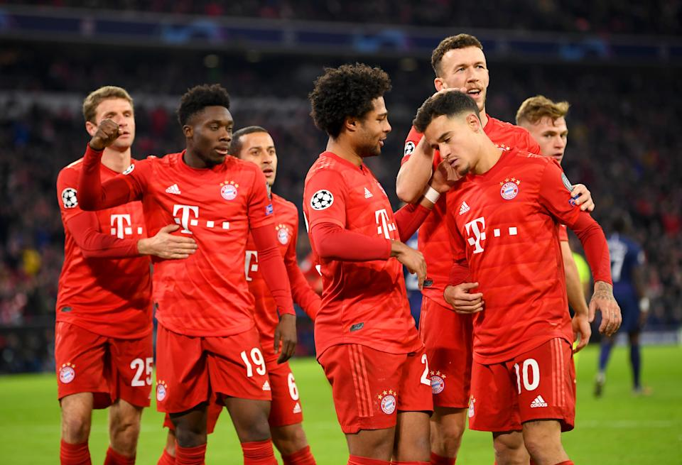 MUNICH, GERMANY - DECEMBER 11: Philippe Coutinho of FC Bayern Munich celebrates with teammates after scoring his team's third goal during the UEFA Champions League group B match between Bayern Muenchen and Tottenham Hotspur at Allianz Arena on December 11, 2019 in Munich, Germany. (Photo by Sebastian Widmann/Bongarts/Getty Images)