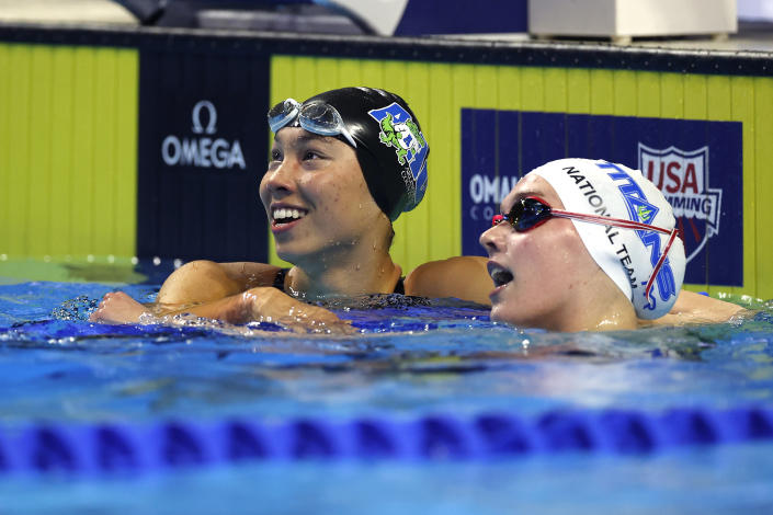 OMAHA, NEBRASKA - JUNE 13: Torri Huske of the United States reacts after setting an American record with Claire Curzan while competing in a semifinal heat for the Women's 100m butterfly during Day One of the 2021 U.S. Olympic Team Swimming Trials at CHI Health Center on June 13, 2021 in Omaha, Nebraska. (Photo by Al Bello/Getty Images)
