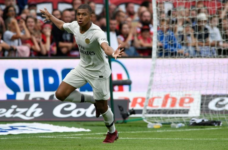 Kylian Mbappe celebrates after putting PSG ahead against Guingamp