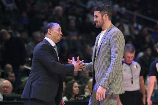 Los Angeles Clippers assistant coach Tyronn Lue, talks with Cleveland Cavaliers forward Kevin Love during timeout in the second half of an NBA basketball game Tuesday, Jan. 14, 2020, in Los Angeles. The Clippers won 128-103. (AP Photo/Mark J. Terrill)