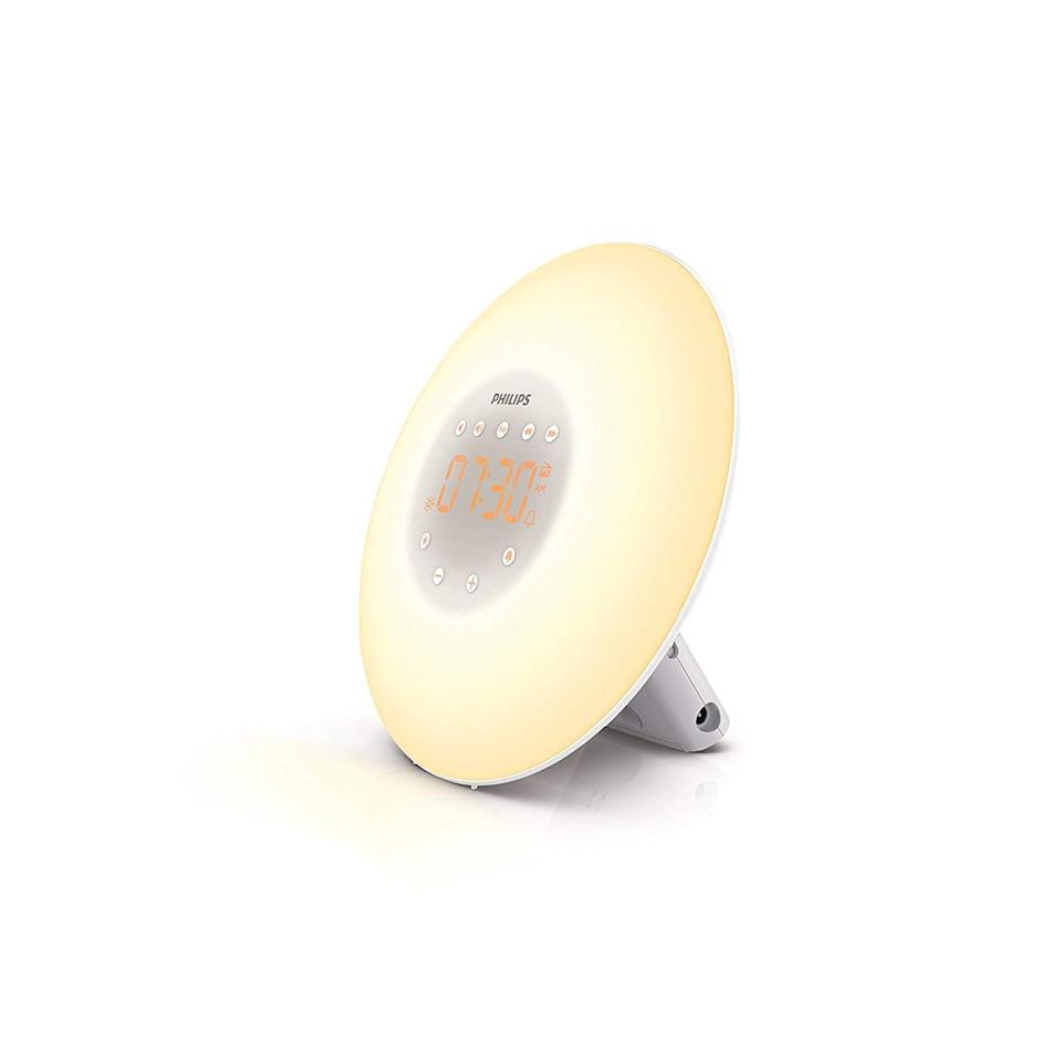 """<p>For the perpetual alarm clock snoozer, this Philips Wake-Up Light Alarm Clock will help them start their day more naturally (and less angrily). The light on the clock simulates the sunrise and sunset to gently hack their circadian rhythm, especially as the days get shorter and, in some cases, <a href=""""https://www.allure.com/story/seasonal-affective-disorder-vs-depression?mbid=synd_yahoo_rss"""" rel=""""nofollow noopener"""" target=""""_blank"""" data-ylk=""""slk:seasonal affective disorder"""" class=""""link rapid-noclick-resp"""">seasonal affective disorder</a> comes into play. They can choose from radio sounds or even built-in natural bird sounds. </p> <p><strong>$96</strong> (<a href=""""https://www.amazon.com/Philips-Wake-Up-Sunrise-Simulation-HF3505/dp/B00E91EGDS"""" rel=""""nofollow noopener"""" target=""""_blank"""" data-ylk=""""slk:Shop Now"""" class=""""link rapid-noclick-resp"""">Shop Now</a>)</p>"""