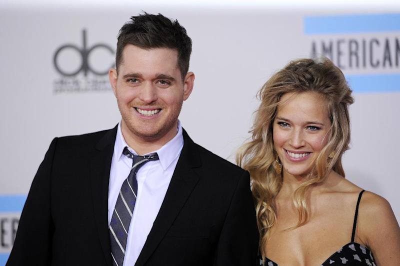 FILE - This Nov. 21, 2010 file photo shows Michael Buble, left, and Luisana Lopilato at the 38th Annual American Music Awards in Los Angeles.  The 37-year-old Canadian singer and his 25-year-old Argentine actress-wife are expecting a baby. They were married in 2011. The couple met in 2009 during a South American concert tour (AP Photo/Chris Pizzello, file)
