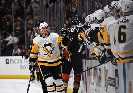 Jan 11, 2019; Anaheim, CA, USA; Pittsburgh Penguins left wing Tanner Pearson (14) celebrates after a goal against the Anaheim Ducks in the third period at the Honda Center. The Penguins defeated the Ducks 7-4. Mandatory Credit: Kirby Lee-USA TODAY Sports