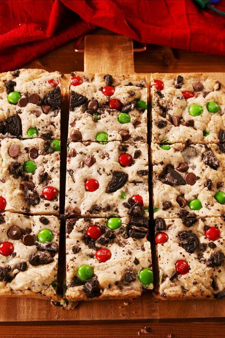 """<p>Loaded with M&Ms, crushed Oreos, and chocolate chips.</p><p>Get the recipe from <a href=""""https://www.delish.com/holiday-recipes/christmas/a25022309/christmas-blondies-recipe/"""" rel=""""nofollow noopener"""" target=""""_blank"""" data-ylk=""""slk:Delish"""" class=""""link rapid-noclick-resp"""">Delish</a>. </p>"""