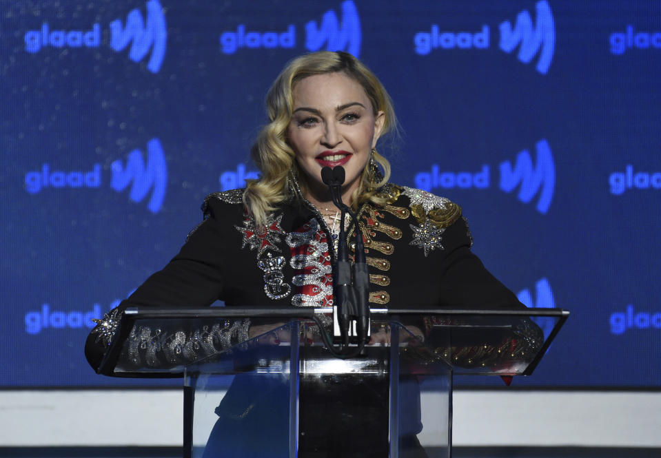 "FILE - In this May 4, 2019 file photo,  Madonna accepts the advocate for change award at the 30th annual GLAAD Media Awards at the New York Hilton Midtown in New York. The 13-track ""Madame X,"" Madge's first LP since the underappreciated 2015's ""Rebel Heart,"" sees her predictably collaborate with the hot young things of pop, Swae Lee, Anitta, Quavo, Maluma, with results that are fine, but boring. It seems more like a checklist than the spark of partnership.  (Photo by Evan Agostini/Invision/AP)"