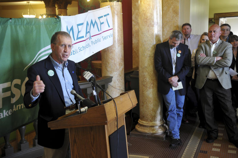 In this May 25, 2011 photo Eric Feaver president of the MEA-MFT, speaks to state employees at the state Capitol in Helena, Mont. Feaver and other education interests lobbied against a bill that would have provided $15 million in funding for public and private preschools in Montana, derailing one of Democratic Gov. Steve Bullock's top priorities. Education groups support funding only public preschools. (Dylan Brown/Independent Record via AP)