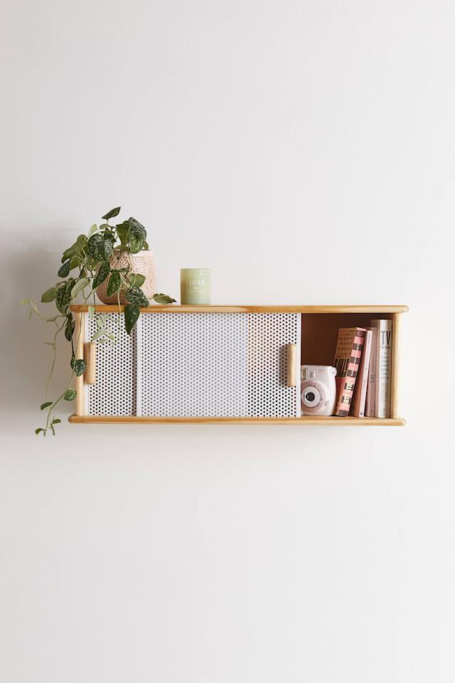 "<p>You can store items in this <a href=""https://www.popsugar.com/buy/Shelby-Wall-Cabinet-557374?p_name=Shelby%20Wall%20Cabinet&retailer=urbanoutfitters.com&pid=557374&price=149&evar1=casa%3Aus&evar9=47315088&evar98=https%3A%2F%2Fwww.popsugar.com%2Fhome%2Fphoto-gallery%2F47315088%2Fimage%2F47315341%2FShelby-Wall-Cabinet&list1=shopping%2Curban%20outfitters%2Capartments%2Csmall%20space%20living%2Capartment%20living%2Chome%20shopping&prop13=mobile&pdata=1"" rel=""nofollow"" data-shoppable-link=""1"" target=""_blank"" class=""ga-track"" data-ga-category=""Related"" data-ga-label=""https://www.urbanoutfitters.com/shop/shelby-wall-cabinet?category=apartment-new-arrivals&amp;color=010&amp;type=REGULAR&amp;size=ONE%20SIZE&amp;quantity=1"" data-ga-action=""In-Line Links"">Shelby Wall Cabinet</a> ($149) and even put a plant on top.</p>"