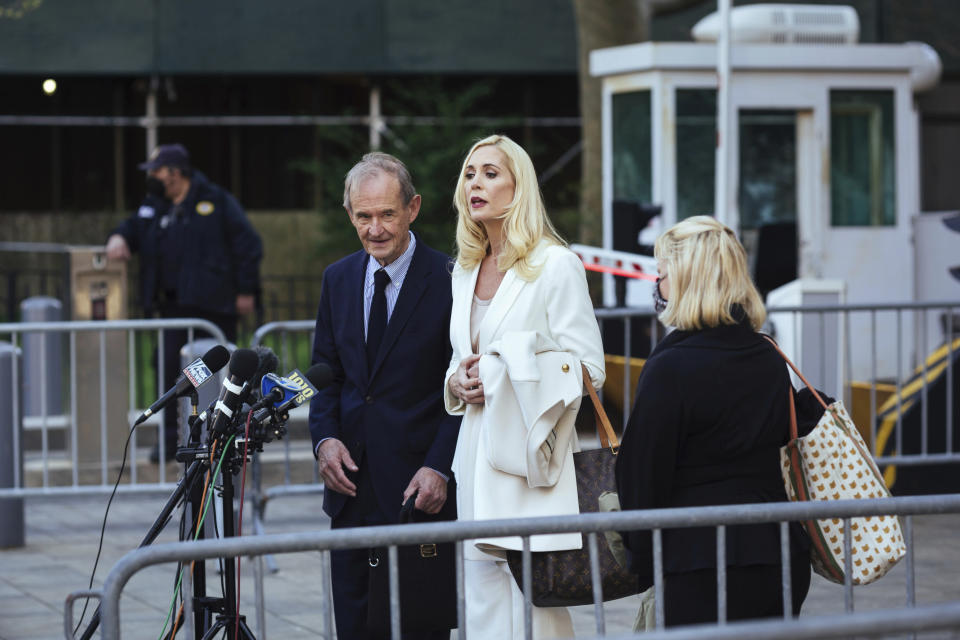 Attorneys David Boies, left, and Sigrid McCawley speak following Ghislaine Maxwell's appearance in Federal Court on Friday, April. 23, 2021, in New York. Ghislaine Maxwell, a British socialite and one-time girlfriend of Epstein, pleaded not guilty to sex trafficking conspiracy and an additional sex trafficking charge that were added in a rewritten indictment released last month by a Manhattan federal court grand jury. (AP Photo/Kevin Hagen)