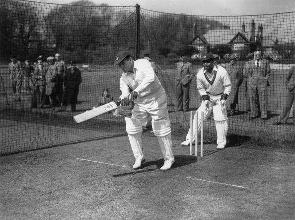 20th April 1950: West Indian cricketer G E Gomez (1919 - 1996) in the practice nets at Eastbourne, with team mate C L Walcott keeping the wicket. (Photo by Jimmy Sime/Central Press/Getty Images)