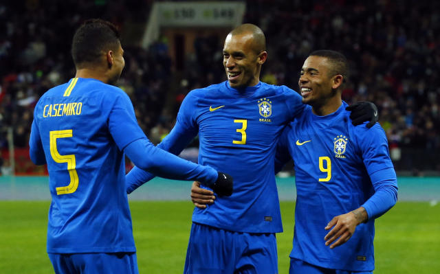 Brazil's Miranda, center, celebrates with Gabriel Jesus and Casemiro, left, after scoring the opening goal during an international friendly soccer match between Russia and Brazil at the Luzhniki stadium in Moscow, Russia, Friday, March 23, 2018. (AP Photo/Alexander Zemlianichenko)