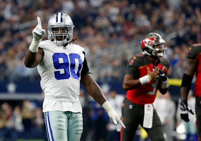 Dallas Cowboys defensive end DeMarcus Lawrence (90) and the team agreed to the parameters of an enormous contract extension. (AP)
