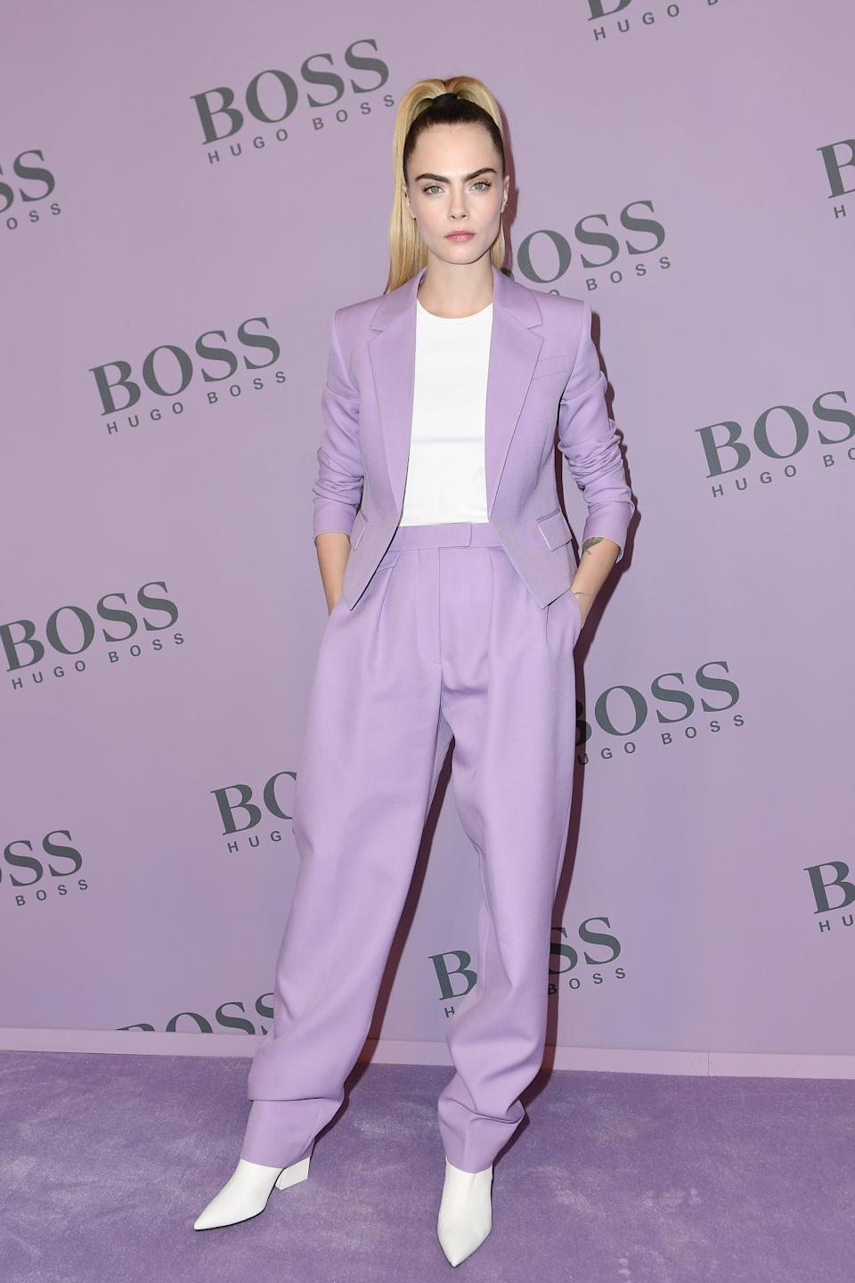MILAN, ITALY - FEBRUARY 23: Cara Delevingne attends the Boss fashion show on February 23, 2020 in Milan, Italy. (Photo by Jacopo Raule/WireImage)