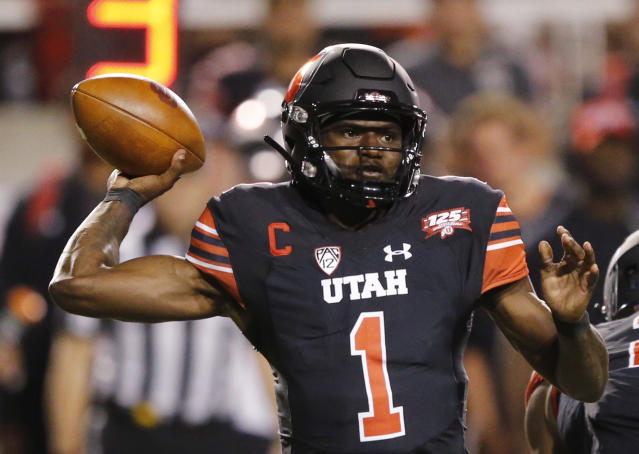 FILE - In this Sept. 15, 2018, file photo, Utah quarterback Tyler Huntley (1) passes the ball against Washington in the first half during an NCAA college football game, in Salt Lake City. The Utes were selected to win the Pac-12 in the preseason media poll and they're also ranked in the preseason coaches' poll. (AP Photo/Rick Bowmer, File)