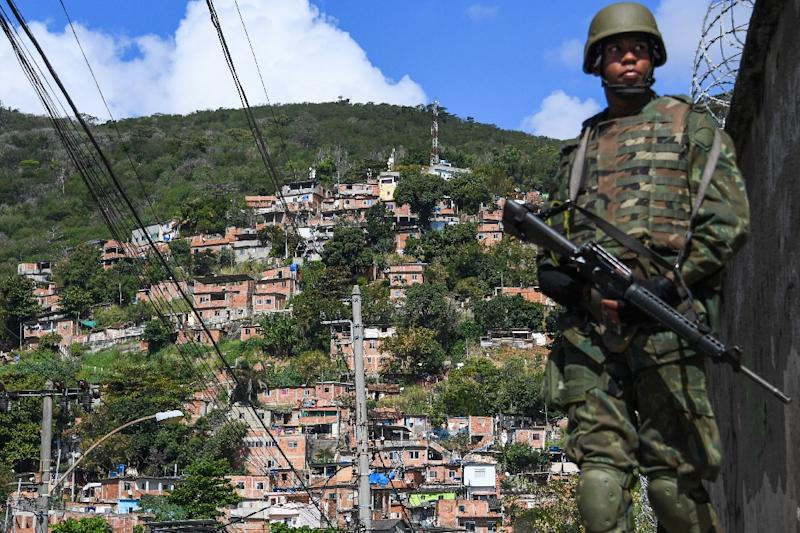 Rio de Janeiro's slums are notorious for crime, violence and drug wars (AFP Photo/Apu Gomes)