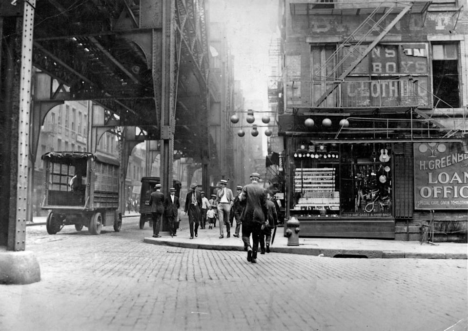 A view of New York City's East Side in the mid-1920s. If you look closely, you'll see stores selling diamonds, fur, and suitcases, as well as an advertisement for a loan office, in the background.