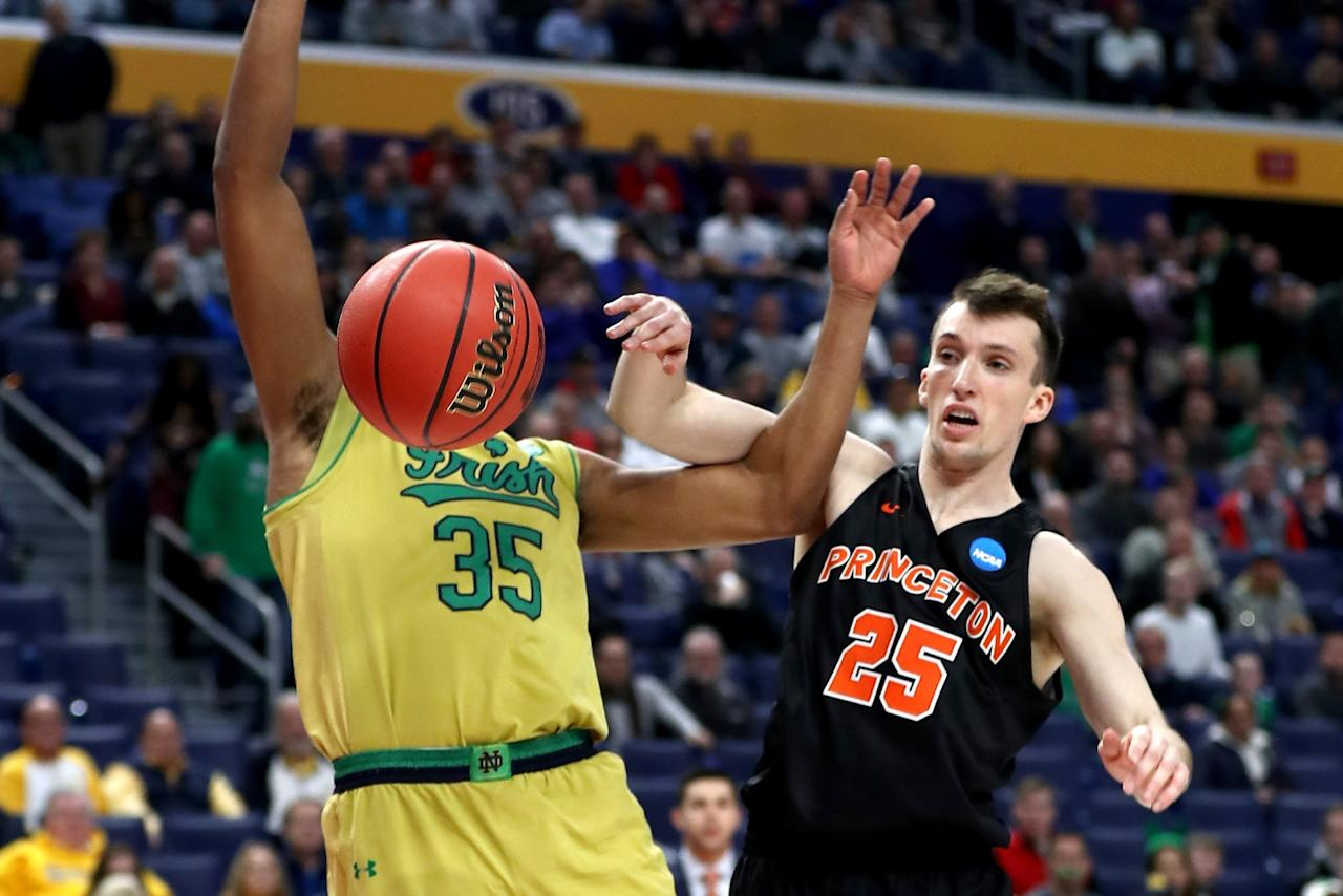 <p>Steven Cook #25 of the Princeton Tigers and Bonzie Colson #35 of the Notre Dame Fighting Irish fight the ball in the first half during the first round of the 2017 NCAA Men's Basketball Tournament at KeyBank Center on March 16, 2017 in Buffalo, New York. (Photo by Elsa/Getty Images) </p>