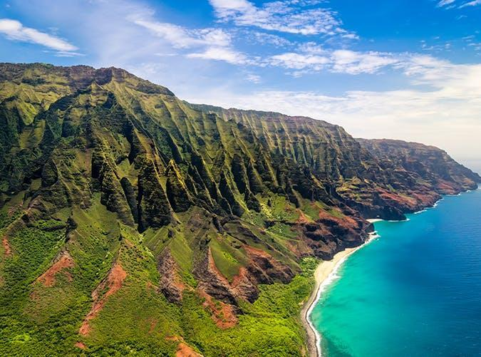 <p>This state park comprises 17 miles of rugged Kauai coastline. Hikers can walk along the cliffs and valleys covered in lush forests while taking in panoramic views of the Pacific.</p>