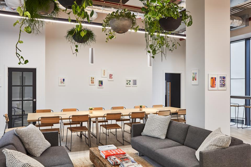 The Collective Canary Wharf's co-working lounge is featured in this photo.