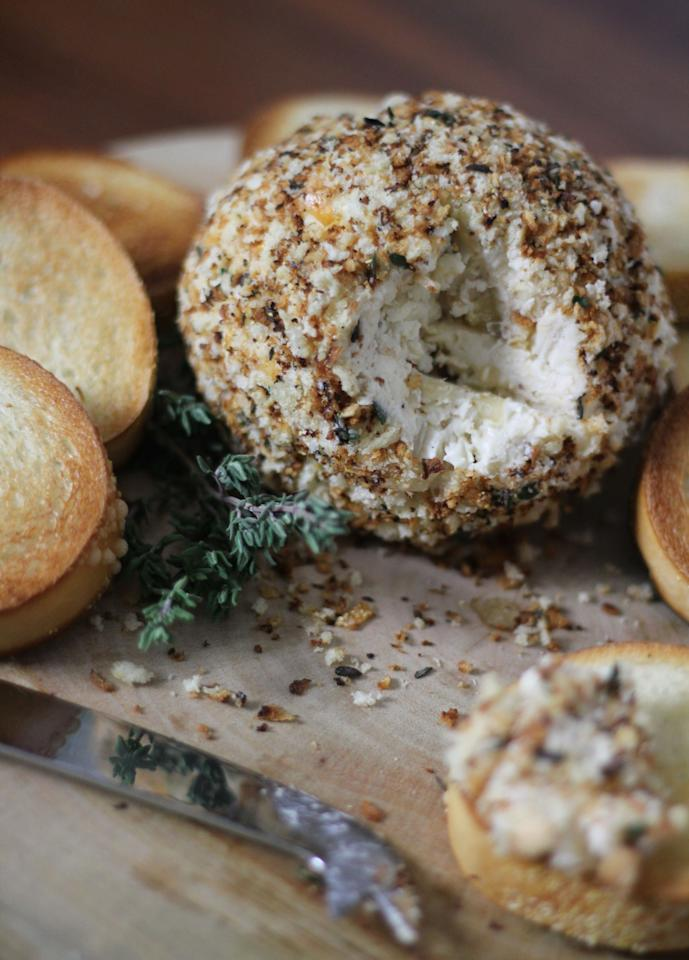 """<p>Rather than serving French Onion soup topped with bread to a crowd, serve a more easily-shared, portable version with all of the same flavor. A French Onion Cheese Ball with toasted baguette slices makes the perfect game-watching appetizer and it much less likely to spill during the celebration of a big play. </p> <p><a href=""""https://www.myrecipes.com/recipe/french-onion-cheese-ball"""">French Onion Cheese Ball Recipe</a></p>"""