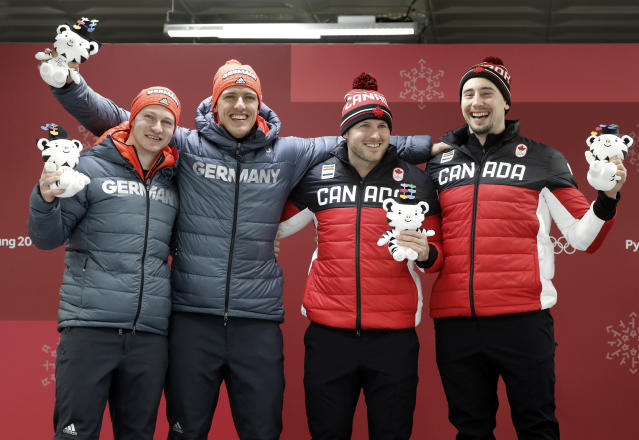 <p>Tied gold medalists Francesco Friedrich and Thorsten Margis of Germany and Justin Kripps and Alexander Kopacz of Canada celebrate during the victory ceremony after the Men's 2-Man Bobsled on day 10 of the 2018 Winter Olympics.<br>(AP Photo/Wong Maye-E) </p>