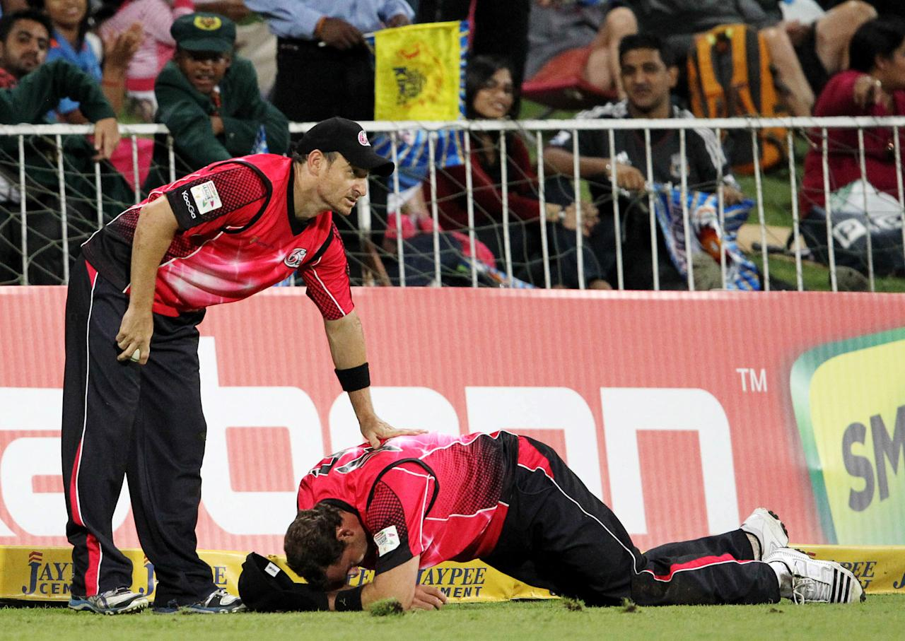 DURBAN, SOUTH AFRICA - OCTOBER 22:  Natahn McCullum (L) of Sydney checks on team-mate Michael Lumb during the Champions League twenty20 match between Sydney Sixers and Mumbai Indians at Sahara Stadium Kingsmead on October 22, 2012 in Durban, South Africa. (Photo by Anesh Debiky / Gallo Images/Getty Images)