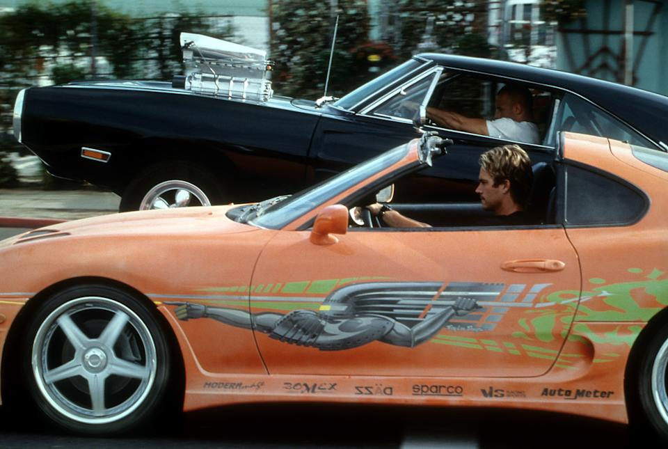 Vin Diesel and Paul Walker racing against each other in a scene from the film 'The Fast And The Furious', 2001. (Photo by Universal/Getty Images)