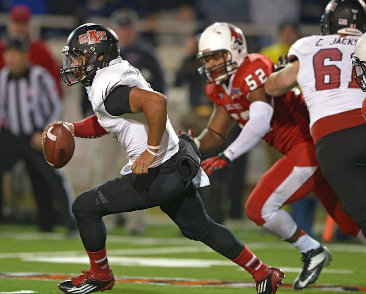 Arkansas State quarterback Fredi Knighten (9) keeps the ball and runs against Ball State in the fourth quarter of the GoDaddy Bowl NCAA college football game in Mobile, Ala., Sunday, Jan. 5, 2014. Arkansas State defeated Ball State, 23-20. (AP Photo/G.M. Andrews)