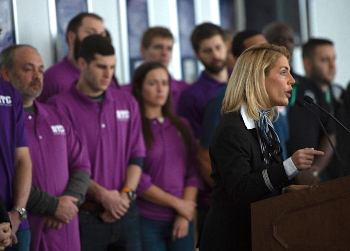Sara Nelson, the International President of the Association of Flight Attendants, speaks during a press conference on aviation safety during the shutdown, as he is joined by airline personnel, air traffic controllers, and employees from the Federal Aviation Administration at Ronald Reagan Washington National Airport in Arlington, Virginia on January 24, 2019. (AFP Photo/Andrew CABALLERO-REYNOLDS)