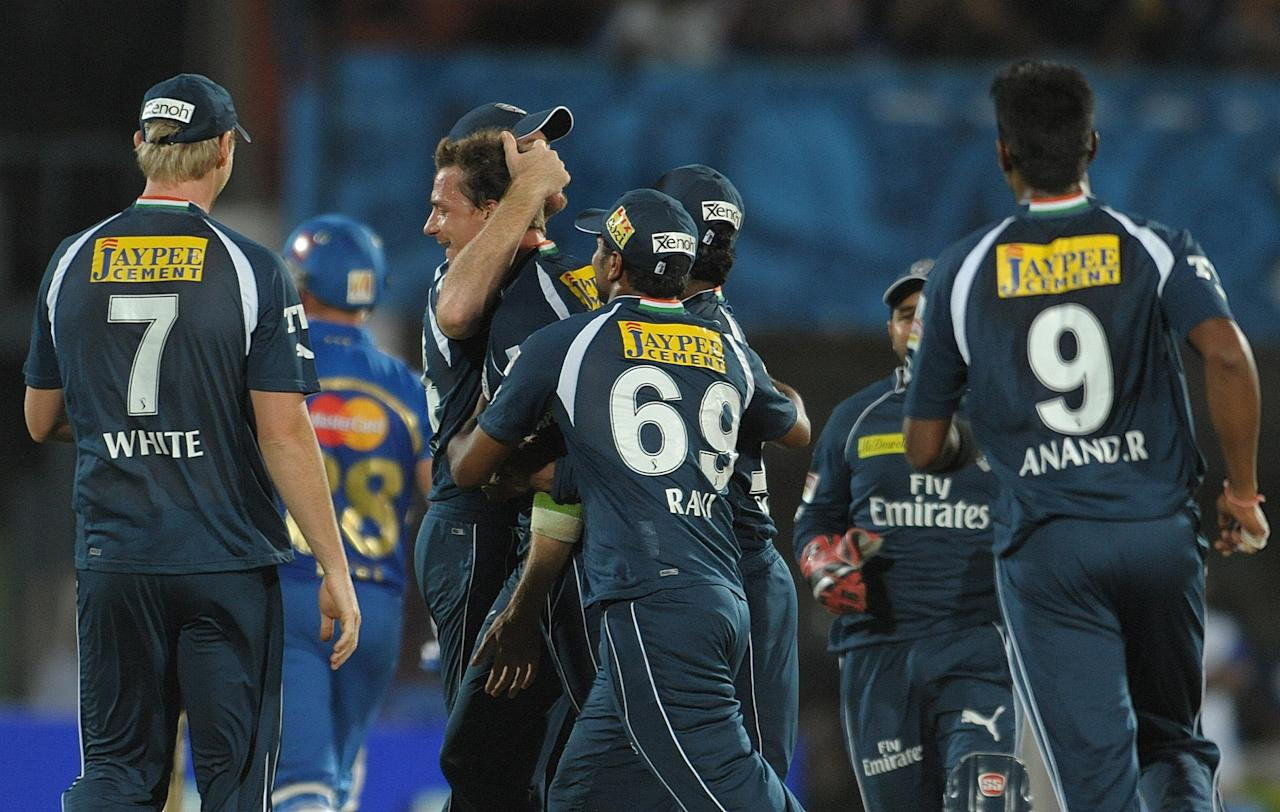 Deccan Chargers bowler Dale Steyn(C) with team members celebrates the wicket of Mumbai Indians  Richard Levi  during the IPL Twenty20  match at Dr. Y.S. Rajasekhara Reddy Cricket Stadium in Visakhapatnam on April 9, 2012. AFP PHOTO / Noah SEELAM.RESTRICTED TO EDITORIAL USE. MOBILE USE WITHIN NEWS PACKAGE. ... (Photo credit should read NOAH SEELAM/AFP/Getty Images)