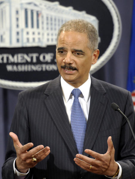 Attorney General Eric Holder takes part in a news conference at the Justice Department in Washington, Wednesday, April 11, 2012. The Justice Department and several states have sued Apple Inc. and major book publishers, alleging a conspiracy to raise the price of electronic books that Attorney General Eric Holder says cost consumers millions of dollars. (AP Photo/Cliff Owen)