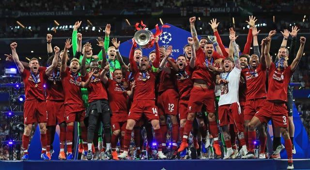 Liverpool's Jordan Henderson lifts the Champions League trophy with his team-mates