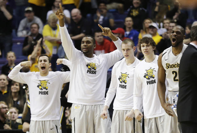 Wichita State celebrates against Cal Poly during the first half of a second-round game in the NCAA college basketball tournament Friday, March 21, 2014, in St. Louis. (AP Photo/Charlie Riedel)