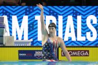 Lilly King reacts after winning the women's 100 breaststroke during wave 2 of the U.S. Olympic Swim Trials on Tuesday, June 15, 2021, in Omaha, Neb. (AP Photo/Charlie Neibergall)
