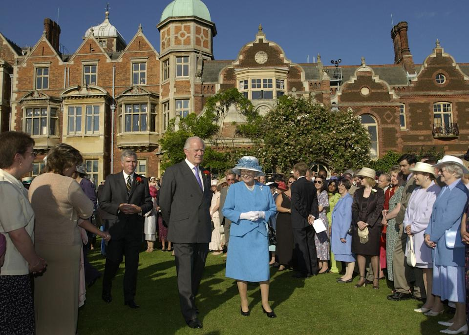 SANDRINGHAM, ENGLAND - JULY 18:  Queen Elizabeth II, accompanied by Sir Timothy Colman of Colman's Mustard, hosts a Garden Party  at Sandringham House in Norfolk on July 18, 2002 in Sandringham,  England. (Photo by Pool/ Anwar Hussein/Getty Images)