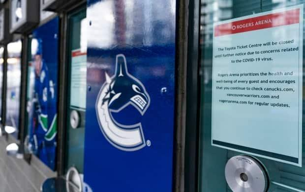 A notice of closure due to COVID-19 is taped to the ticket window at Rogers Arena, home of the Vancouver Canucks, in January. (Rich Lam/Getty Images - image credit)