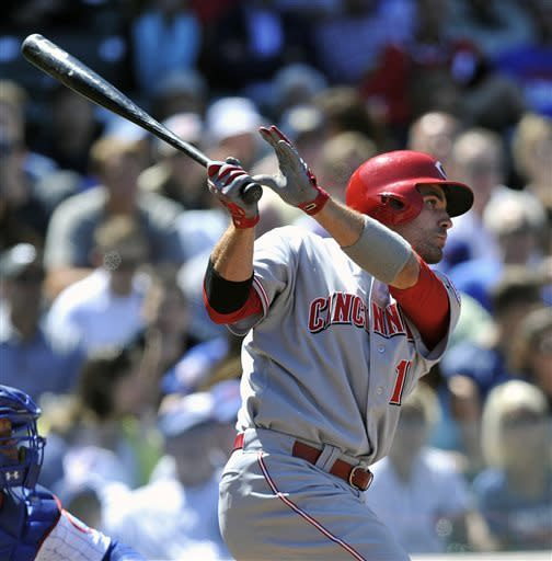 Cincinnati Reds' Joey Votto hits an RBI single against the Chicago Cubs during the fifth inning of a baseball game Thursday, June 13, 2013, in Chicago. (AP Photo/Jim Prisching)