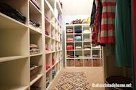 """<p>But shelving units that take up nearly all of the wall space create dedicated areas for each family member. Meanwhile, wicker baskets on the bottom row of the cubbies create concealed storage for items you might not want on full display. </p><p><em><a href=""""http://www.thehandmadehome.net/2014/03/the-family-closet/"""" rel=""""nofollow noopener"""" target=""""_blank"""" data-ylk=""""slk:See more at The Handmade Home »"""" class=""""link rapid-noclick-resp"""">See more at The Handmade Home »</a></em></p><p><strong>What you'll need: </strong><span class=""""redactor-invisible-space"""">bookshelves, $65, <a href=""""https://www.amazon.com/ClosetMaid-Cubeicals-Organizer-12-Cube-White/dp/B00E964EM6/?tag=syn-yahoo-20&ascsubtag=%5Bartid%7C10072.g.36006557%5Bsrc%7Cyahoo-us"""" rel=""""nofollow noopener"""" target=""""_blank"""" data-ylk=""""slk:amazon.com"""" class=""""link rapid-noclick-resp"""">amazon.com</a></span><br></p>"""