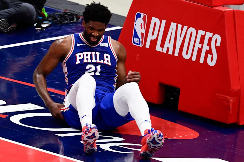 Philadelphia 76ers center Joel Embiid winces after a hard fall against the Washington Wizards.