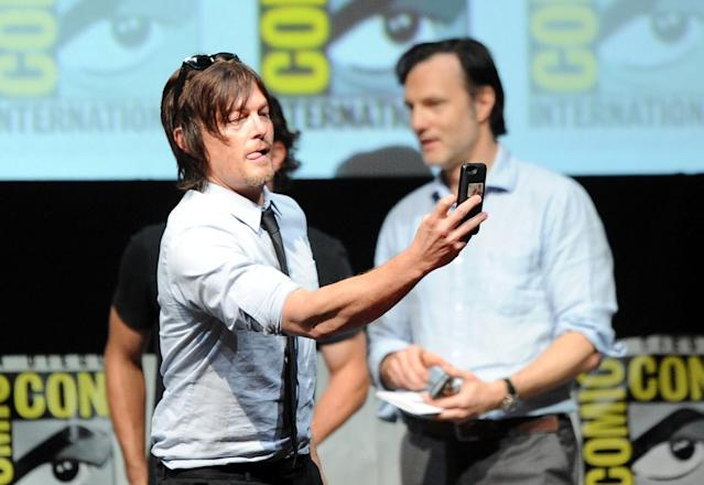 "Norman Reedus and David Morrissey speak onstage at AMC's ""The Walking Dead"" panel during Comic-Con International 2013 at San Diego Convention Center on July 19, 2013 in San Diego, California."