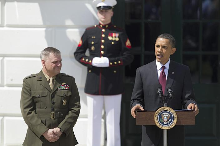 Joint Chiefs Vice Chairman Gen. James Cartwright looks on at left as President Barack Obama speaks during an event to welcome the Wounded Warrior Project's soldier ride to the White House in Washington in 2011. (Photo: Evan Vucci/AP)