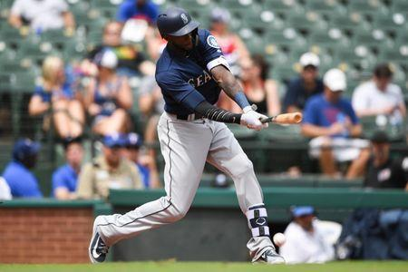 FILE PHOTO: Aug 8, 2018; Arlington, TX, USA; Seattle Mariners left fielder Cameron Maybin (10) hits an RBI single during the seventh inning at Globe Life Park in Arlington. Mandatory Credit: Shanna Lockwood-USA TODAY Sports - 11047286