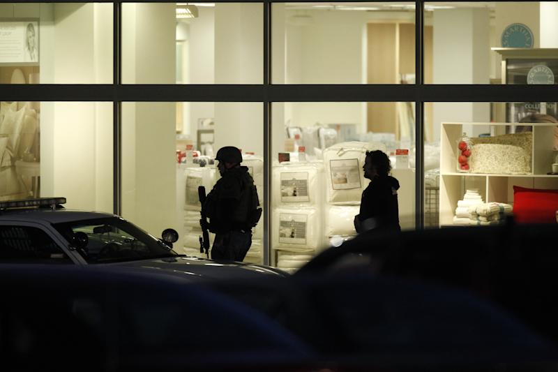 CORRECTS LOCATION OF MALL - Law enforcement personnel work the scene of a shooting at the Clackamas Town Center in Portland, Ore. Tuesday, Dec. 11, 2012. A gunman is dead after opening fire in the Portland, Ore., area shopping mall Tuesday, killing two people and wounding another, sheriff's deputies said. (AP Photo/The Oregonian, Bruce Ely) MAGS OUT; TV OUT; LOCAL TV OUT; LOCAL INTERNET OUT; THE MERCURY OUT; WILLAMETTE WEEK OUT; PAMPLIN MEDIA GROUP OUT