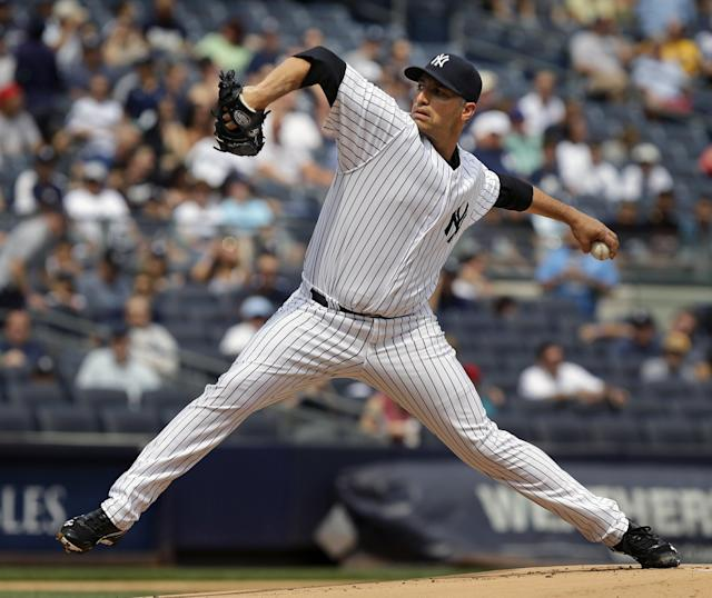 New York Yankees starting pitcher Andy Pettitte throws during the first inning of the baseball game at Yankee Stadium Sunday, Sept. 1, 2013 in New York. (AP Photo/Seth Wenig)