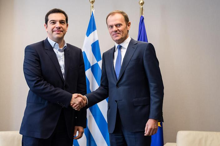 European Council President Donald Tusk (R) welcomes Greek Prime Minister Alexis Tsipras on February 4, 2015 at the EU Council headquarters in Brussels (AFP Photo/Geert Vanden Wijngaert)
