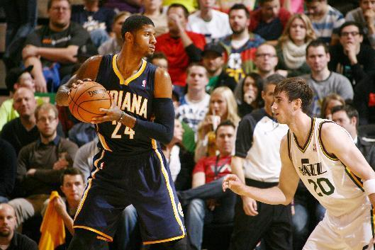 SALT LAKE CITY, UT - DECEMBER 04: Paul George #24 of the Indiana Pacers controls the ball against Gordon Hayward #20 of the Utah Jazz at EnergySolutions Arena on December 04, 2013 in Salt Lake City, Utah. (Photo by Melissa Majchrzak/NBAE via Getty Images)