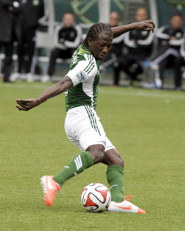 Portland Timbers midfielder Diego Chara shoots for a goal during the second half of an MLS soccer game against the Seattle Sounders in Portland, Ore., Saturday, April 5, 2014. Chara scored two goals as the teams tied 4-4. (AP Photo/Don Ryan)